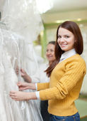 Mature mother with daughter chooses white gown — Stock Photo