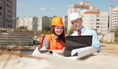 Portrait of two builders at building site — Stock Photo