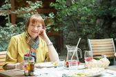 Mature woman having lunch in outdoor restaurant — Stock Photo