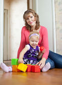 Mother plays with baby in home — Stock Photo
