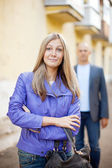 Man walks behind woman — Stock Photo