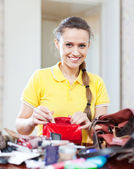Beautiful inconsiderate woman found thing in purse — Stock Photo