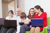 Multigeneration family using laptops — Stock Photo