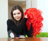 Brunette woman with red periwig — Stock Photo