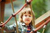 Baby girl climbing at ropes — Stock Photo