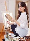 Long-haired female artist — Stock Photo