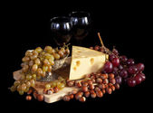 Grapes and cheese with wine — Stock Photo