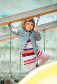 Girl in jacket at playground — Stock Photo