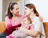 Mature mother comforts crying adult daughter — Stock Photo