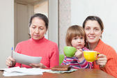 Family fills in utility payments bills — Stock Photo