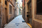 Old narrow street of european city. Barcelona — Stock Photo
