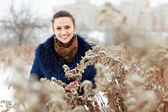 Girl in blue coat at wintry park — Stock Photo