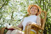 Mature woman in spring garden — Stock Photo