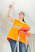 Painter paints the ceiling — Stock Photo