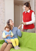 Woman hires babysitter for her child — Stock Photo