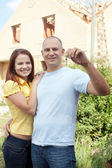 Happy couple against building new house — Stock Photo