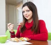 Brunette woman having dinner — Stock Photo