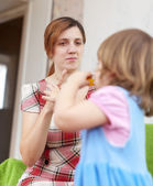 Mother scolds her child in home — Stock Photo