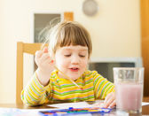 Two year child painting with watercolor — Stock Photo