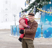 Man with child in Christmas time at Vladimir — Stock Photo