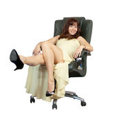 Happy woman sitting on office armchair — Photo