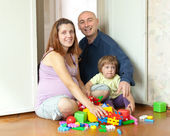 Happy family in home — Stockfoto