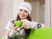 Woman warms with cup of tea — Stock Photo
