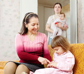 Two women with children — Stock Photo