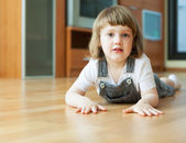 Two year child on parquet — Stock Photo