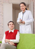 Doctor and female patient — Stock Photo