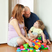 Happy family in home interior — Stock Photo