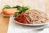 Spaghetti pasta with sausages — Stock Photo
