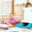 Two  children playing with paper   — Stock Photo