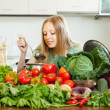 Woman cooking with heap of raw vegetables   — Stock Photo