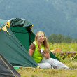 Happy  hiker in front of camp tent   — Stock Photo