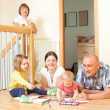 Portrait of happy smiling three generations family sits on parqu — Stock Photo