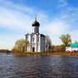 Church of Intercession on River Nerl in flood — Stock Photo #28693775