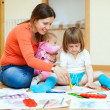 Happy mother and her children drawing on paper — Stock Photo