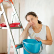 Mature wommakes repairs at home — Stock Photo #28694077