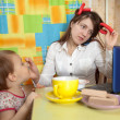 Mother feeding baby and  using  latop — Stock Photo