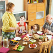 Happy  multigeneration family having holiday dinner   — Stock Photo
