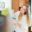housewife cleaning  glass — Stock Photo