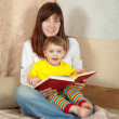 Mother and daughter reading book — Stock Photo #28694445