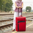 Woman   waiting  train on  railroad — Stock Photo