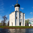 Church of Intercession on River Nerl in flood — Stock Photo #28694503