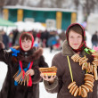 Girl with pancake during Maslenitsa festival — Stock Photo