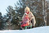 2 years child sliding downhill — Stock Photo