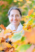 Happy mature woman in autumn — Stock Photo