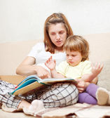 Mother showing book to her baby — Stock Photo