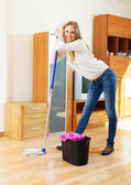 Long-haired housewife with mop — Stock Photo